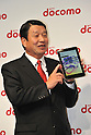 February 24, 2011 - Tokyo, Japan - Ryuji Yamada, president and CEO of NTT Docomo, holds up their new smartphone Medias tablet during a press conference where NTT Docomo unveils three new smartphone models: the XPERIA, the Medias and the Optimus. (Photo by Koichi Mitsui/AFLO)