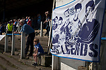 Home fans in the shed watching the first-half action at Palmerston Park, Dumfries as Queen of the South hosted Dundee United in a Scottish Championship fixture. The home has played at the same ground since its formation in 1919. Queens won the match 3-0 watched by a crowd of 1,531 spectators.