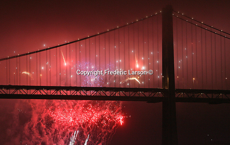 An annual fireworks display lit up the sky 5/10 near one of the towers of the Bay Bridge in San Francisco at Piers 30/32 in California.