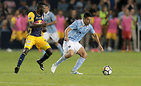 Kansas City, KS - Wednesday September 20, 2017: Kemar Lawrence, Roger Espinoza during the 2017 U.S. Open Cup Final Championship game between Sporting Kansas City and the New York Red Bulls at Children's Mercy Park.