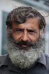 A Portrait of an elderly man with beard. Photo by Sanad Ltefa