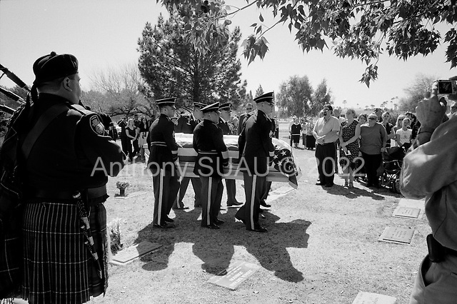 Tucson, Arizona.USA.March 16, 2007..The body of National Guardsman Staff Sgt. Darrel D. Kasson, 43, of Florence, Arizona carried by Honor Guard at the Evergreen Cemetery. He died March 4 in Tikrit, Iraq, of wounds suffered when an improvised explosive device detonated near his vehicle at Bayji, Iraq. He was assigned to the 259th Security Forces Company, Phoenix.