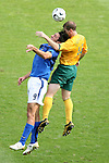 26 June 2006: Luca Toni (ITA) (9) and Scott Chipperfield (AUS) (14) challenge for a header. Italy (1st place in Group E) defeated Australia (2nd place in Group F) 1-0 at Fritz-Walter Stadion in Kaiserslautern, Germany in match 53, a Round of 16 game, in the 2006 FIFA World Cup.