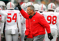 Ohio State Buckeyes head coach Urban Meyer signals to an official during the first quarter of a NCAA college football game between the Michigan State Spartans and the Ohio State Buckeyes on Saturday, November 10, 2018 at Spartan Stadium in East Lansing, Michigan. [Joshua A. Bickel/Dispatch]