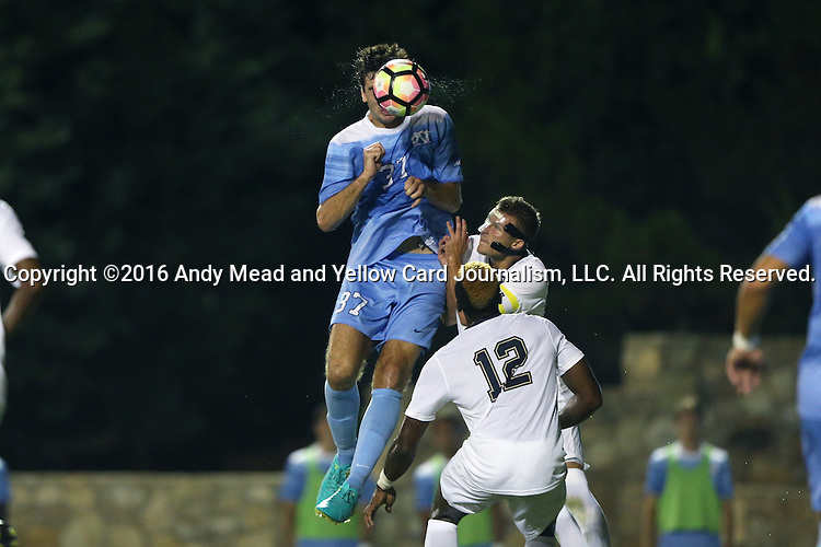 16 September 2016: North Carolina's Walker Hume (37) heads the ball over Pitt's Stephane Pierre (12) and Bryce Cregan (behind). The University of North Carolina Tar Heels hosted the University of Pittsburgh Panthers in Chapel Hill, North Carolina in a 2016 NCAA Division I Men's Soccer match. UNC won the game 1-0.