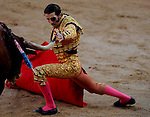 Spanish matador Juan Jose Padilla performs a pass with capote to a Torrehandilla´s bull during the last corrida of the San Fermin Festival, on July 14, 2012, in the Northern Spanish city of Pamplona . AFP PHOTO/Pedro ARMESTRE. (c) Pedro ARMESTRE