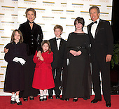 "2004 Kennedy Center Honoree Warren Beatty, right, arrives with his wife, Annette Bening, and children, from left, Isabel, Ella, Benjamin, and Kathryn at the Harry S. Truman Building (Department of State) in Washington, D.C. on December 4, 2004 for a dinner hosted by United States Secretary of State Colin Powell.  At the dinner six performing arts legends will receive the Kennedy Center Honors of 2004.  This is the 27th year that the honors have been bestowed on ""extraordinary individuals whose unique and abundant artistry has contributed significantly to the cultural life of our nation and the world"" said John F. Kennedy Center for the Performing Arts Chairman Stephen A. Schwarzman.  The award recipients are: actor, director, producer, and writer Warren Beatty; husband-and-wife actors, writers and producers Ossie Davis and Ruby Dee; singer and composer Elton John; soprano Joan Sutherland; and composer and conductor John Williams..Credit: Ron Sachs / CNP"