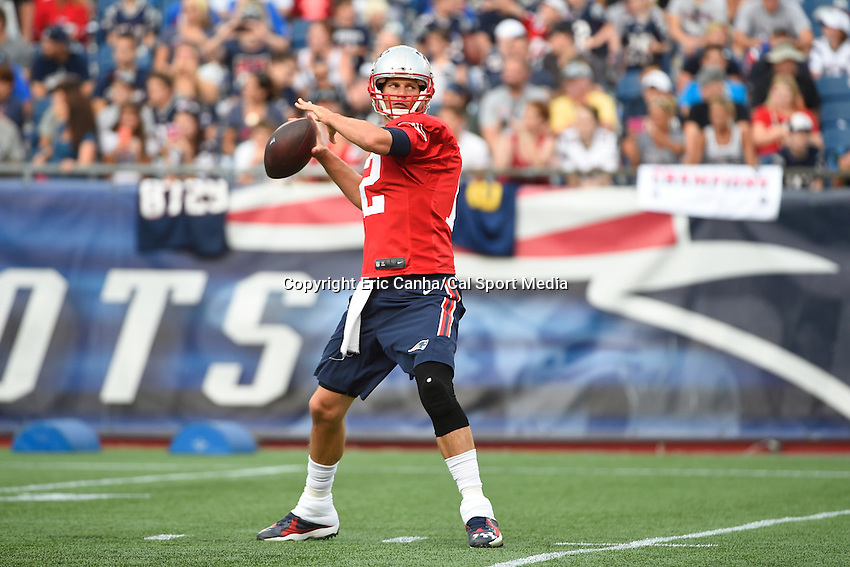 August 5, 2015: New England Patriots quarterback Tom Brady (12) throws a pass during the New England Patriots training camp held on the the game field at Gillette Stadium in Foxborough Massachusetts. Eric Canha/CSM