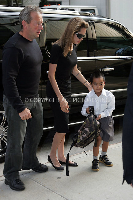 WWW.ACEPIXS.COM . . .  ....September 7 2007, New York City....Actress Angelina Jolie took her adpoted son Maddox to the Lycee Francais de New York on the Upper East Side of Manhattan. Maddox jumped out of the car and dropped his book bag, which her quickly recoved and walked hand in hand into the school.....Please byline: DAVID MURPHY - ACEPIXS.COM.. *** ***  ..Ace Pictures, Inc:  ..Tel: 646 769 0430..e-mail: info@acepixs.com..web: http://www.acepixs.com