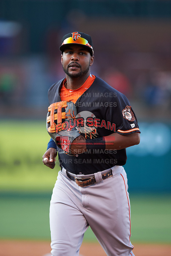 Fresno Grizzles outfielder L.J. Hoes (28) jogs to the dugout in between innings during a game against the Oklahoma City Dodgers on June 1, 2015 at Chickasaw Bricktown Ballpark in Oklahoma City, Oklahoma.  Fresno defeated Oklahoma City 14-1.  (Mike Janes/Four Seam Images)