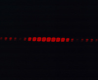 DOUBLE SLIT LASER LIGHT DIFFRACTION PATTERN<br /> Slit Width = 0.04mm; Separation = 0.25mm<br /> The coherent light waves from two slits spread out and interfere, producing alternating maxima and minima, or bright and dark fringes.  Light source is laser diode, Wavelength = 660-680 nm, Output < 5 mW.