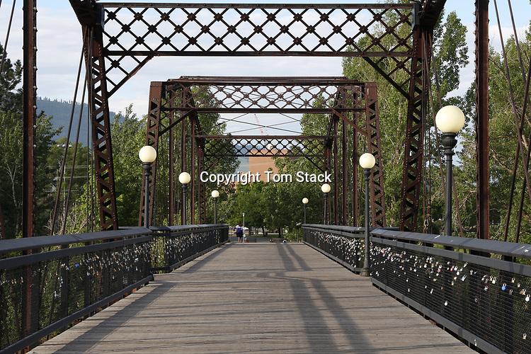 The landmark Van Buren Footbridge over the Clark Fork River to the campus of the University of Montana in Missoula, Montana.