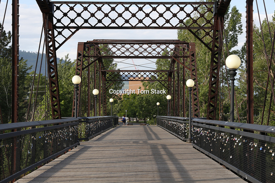 The landmark Van Buren Footbridge over the Clark Fork River to the campus of the University of Montana in Missoula, Montana.