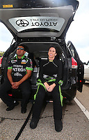 May 20, 2016; Topeka, KS, USA; NHRA funny car driver Alexis DeJoria (right) with a crew member during qualifying for the Kansas Nationals at Heartland Park Topeka. Mandatory Credit: Mark J. Rebilas-USA TODAY Sports