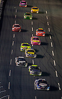 Cars make their down the front stretch during the Bank of America 500 NASCAR race at Lowes's Motor Speedway in Concord, NC.