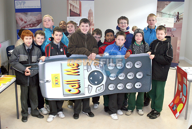 "Students from St. Josephs CBS Sundays Gate with the Drogheda Youth Development ""Call Me"" phone at the Barbican Parish Centre Open Day...Photo NEWSFILE/Jenny Matthews.(Photo credit should read Jenny Matthews/NEWSFILE)....This Picture has been sent you under the condtions enclosed by:.Newsfile Ltd..The Studio,.Millmount Abbey,.Drogheda,.Co Meath..Ireland..Tel: +353(0)41-9871240.Fax: +353(0)41-9871260.GSM: +353(0)86-2500958.email: pictures@newsfile.ie.www.newsfile.ie.FTP: 193.120.102.198."