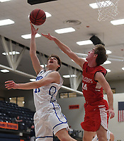 NWA Democrat-Gazette/J.T. WAMPLER Rogers' Elliot Paschal takes a shot over Carl Junction's Teagan Armentrout Thursday Dec. 6, 2018 at the Arvest HoopFest at Heritage High School in Rogers. Rogers won 54-50.