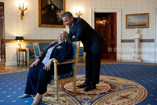 United States President Barack Obama talks with Presidential Medal of Freedom recipient Toni Morrison in the Blue Room of the White House in Washington, D.C. on May 29, 2012. .Mandatory Credit: Pete Souza - White House via CNP