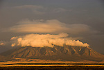 Clouds from afternoon storm gather around Carizzo Mountain across the Tularosa Valley at sundown, New Mexjck