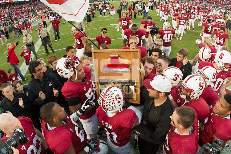 Stanford, CA -- November 23, 2013:  Stanford's Shayne Skov with the Axe after defeating Cal 63-13 at Stanford Stadium.