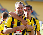 Phoenix's Jeremy Brockie, centre, is congratulated by Alex Rodriguez, right as he celebrates after scoring against the Brisbane Roar in the A-League football match at Westpac Stadium, Wellington, New Zealand, Sunday, January 04, 2015. Credit: Dean Pemberton