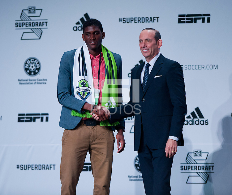 #8 overall pick Damion Lowe of the Seattle Sounders stands on stage with MLS commissioner Don Garber during the MLS SuperDraft at the Pennsylvania Convention Center in Philadelphia, PA, on January 16, 2014.