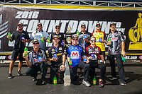 Sep 18, 2016; Concord, NC, USA; (front row from left) NHRA pro stock drivers Jason Line , Vincent Nobile , Allen Johnson , Erica Enders-Stevens (back row from left) Shane Gray , Chris McGaha , Drew Skillman , Bo Butner , Jeg Coughlin Jr and Greg Anderson pose for a photo with the championship trophy during the Carolina Nationals at zMax Dragway. Mandatory Credit: Mark J. Rebilas-USA TODAY Sports