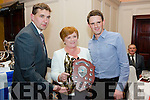 Maurice Fitzgerald and Catherine O'Sullivan presenting Daniel O'Sullivan with the Player of the Year Trophy at the St Mary's Dinner Dane on Saturday night.