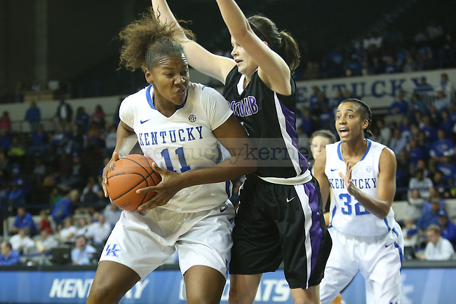 Kentucky Wildcats forward DeNesha Stallworth (11) driving to the basket against Lipscomb Lady Bisons guard Maya Dillard (1) during the first half of the UK Hoops basketball game vs. Lipscomb on Thursday, November 21, 2013, in Lexington, Ky. Photo by Kalyn Bradford | Staff