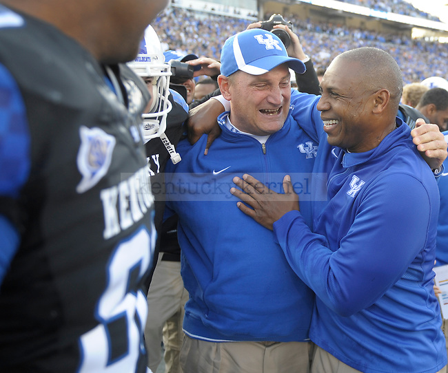Kentucky Wildcats head coach Joker Phillips is congratulated by special teams Greg Nord during the second half of the University of Kentucky football game against Tennessee at Commonwealth Stadium in Lexington, Ky., on 11/26/11. Uk won the game 10-7. Photo by Mike Weaver | Staff