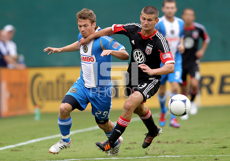 WASHINGTON, D.C. - AUGUST 19, 2012:  Lionard Pajoy (23) of DC United gets the ball away from Antoine Hoppenot (29) of the Philadelphia Union during an MLS match at RFK Stadium, in Washington DC, on August 19. The game ended in a 1-1 tie.