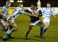 Cambridge University / Oxford University..Pcubed 23rd Rugby League Varsity match..The Athletic Ground, Richmond, March 5, 2003..Pic : Max Flego... Oxfords Duce Gotora holds of Cambridge's Rhodri Hughes