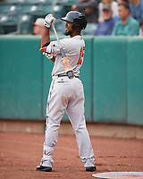 Teoscar Hernandez (15) of the Fresno Grizzlies during the game against the Salt Lake Bees in Pacific Coast League action at Smith's Ballpark on April 17, 2017 in Salt Lake City, Utah. The Bees defeated the Grizzlies 6-2. (Stephen Smith/Four Seam Images)