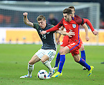Germany's Toni Kroos tussles with England's Adam Lallana during the International Friendly match at Olympiastadion.  Photo credit should read: David Klein/Sportimage