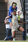 27 October 2013: Duke's Laura Weinberg (behind) kicks the ball past Pittsburgh's Kaila Jenkins (7). The Duke University Blue Devils hosted the Pittsburgh University Panthers at Koskinen Stadium in Durham, NC in a 2013 NCAA Division I Women's Soccer match. Duke won the game 6-3.