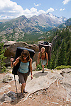 women hinking with bouldering pads, sunny, day, summer, morning, Rocky Mountain National Park, Rocky Mountains, Colorado, USA