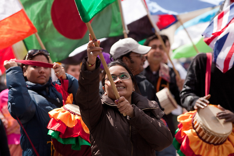 Bhakti Shah wave India's flag during the International Street Fair parade on Court Street in Athens, Ohio on Saturday, April 20, 2013. Photo by Chris Franz
