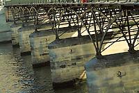 Pylons on the underside of the Pont des Arts footbridge traversing the Seine, Paris, France.