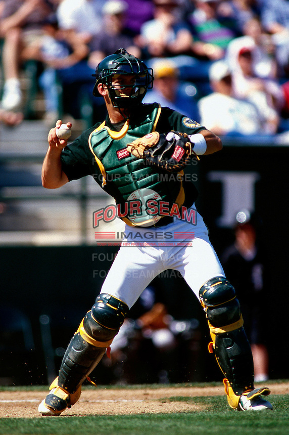A.J. Hinch of the Oakland Athletics participates in a Major League Baseball Spring Training game during the 1998 season in Phoenix, Arizona. (Larry Goren/Four Seam Images)