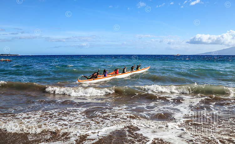 Local canoe club teams paddle outrigger canoes off of Hanakao'o Beach Park (or Canoe Beach), Lahaina, Maui.