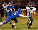 Damonte Ranch Mustangs receiver Samuel Banghart is hit by Carson Senators Nolan Shine during their football game played on Friday night, October 4, 2013 at Carson High School.