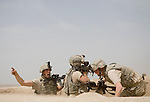 As their command post comes under attack, Specialist Adam Holmgren, left, yells instructions to his weapons teammate, Private Michael Newton, right, of the 82nd Airborne, 1/508, Alpha Company, Third Platoon in Sangin, Helmand province, Afghanistan on Thursday, April 5, 2007. The firefight, less than 24 hours into the air assault on Sangin raged for over five hours.