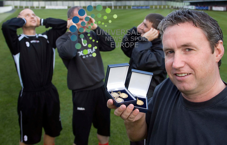 John Miller coach of Beith Juniors, holding his medals and tell members of his team how may finals he has played in. 2 October  2008. Picture: Maurice McDonald/ Universal News And Sport (Scotland)......... ........... .