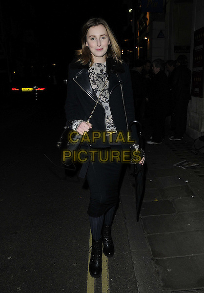 Laura Carmichael.departed after the evening performance of 'Uncle Vanya', Vaudeville Theatre, The Strand, London, England, .UK, 23rd November 2012..full length black biker coat jacket leather skirt ankle boots tights cross body bag grey gray top .CAP/CAN.©Can Nguyen/Capital Pictures.
