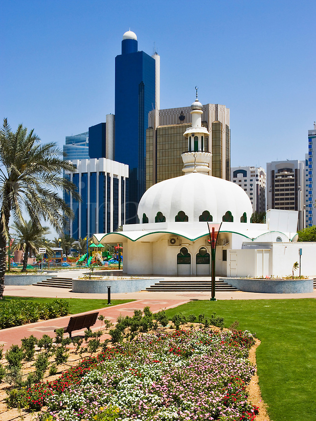 View of mosque and modern commercial buildings in  Abu Dhabi city centre/center..United Arab Emirates.