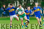 Thomas Kennelly, Ballydonoghue under pressure from Brendan O'Mahony, St Senans watched by Mark Behan and Jason Browne, St Senans at the North Kerry Championship Final played in Moyvane on Sunday.