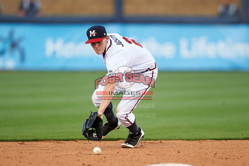 Mississippi Braves second baseman Corban Joseph (2) fields a ground ball during a game against the Pensacola Blue Wahoos on May 27, 2015 at Trustmark Park in Pearl, Mississippi.  Pensacola defeated Mississippi 7-5 in fourteen innings.  (Mike Janes/Four Seam Images)