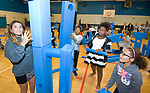 WATERBURY, CT-101317JS10-- Children at the Boys and Girls Club of Greater Waterbury, play with innovative play equipment following the unveiling of the new Imagination Playground at the club on Friday. The equipment was donated by The CarMax Foundation and national non-profit KaBOOM!. <br /> Jim Shannon Republican-American