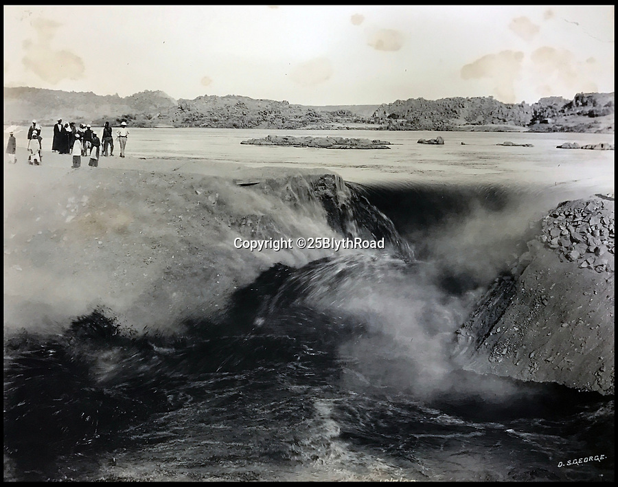 BNPS.co.uk (01202 558833)Pic: 25BlythRoad/BNPS<br /> <br /> This picture shows the power of the Nile as the Aswan dam was being built after the annual rains had swelled its flow.<br /> <br /> An unseen album of pictures reveal the epic construction work on the first Nile dam at Aswan  in 1900.<br /> <br /> Built by British engineers with a workforce of thousands not seen in Egypt since the time of the Pharaohs. The scheme was the largest construction project in the world at the time.<br /> <br /> It's aim was to control the notorious waters of the mighty Nile river by storing the annual flood and releasing the waters over time.