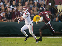 Hawgs Illustrated/BEN GOFF <br /> Austin Allen, Arkansas quarterback, throws the ball as he takes a hit from Skai Moore, South Carolina linebacker, in the third quarter Saturday, Oct. 7, 2017, during the game at Williams-Brice Stadium in Columbia, S.C.